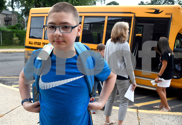 8/31/2017 Mike Orazzi | Staff Anthony Smith arrives for the first day of school at the Eli Terry Middle School in Plymouth Wednesday.