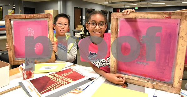 080317 Wesley Bunnell | Staff Aaron Ding, age 11, and Jazlyn Banks, age 10, hold their screens they designed for making custom t-shirts during Graphic Design & Digital Specialty Printing at CCSU on Friday afternoon. The program is part of CCSU's Office of Continuing Education summer program Tech it Out 2017.