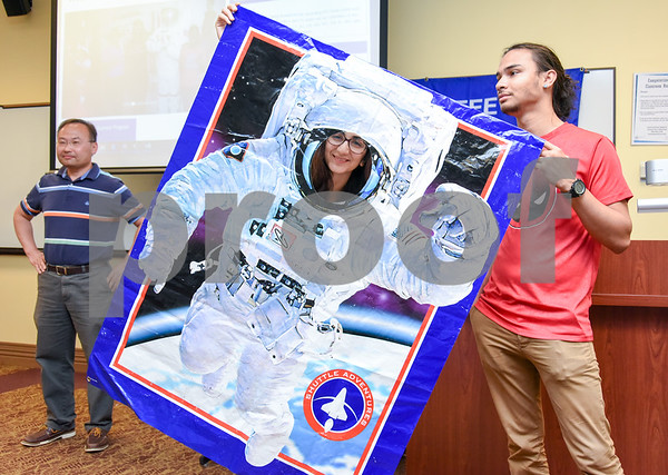 080317 Wesley Bunnell | Staff Trinity College student and summer instructor Mariam Avagyan poses in a cutout of an astronaut at the conclusion of the Zero Robotics class at CCSU on Friday afternoon. Students developed a program to control a SPHERES satellite as part of a contest with other schools to be held on the International Space Station. The program is part of CCSU's Office of Continuing Education summer program Tech it Out 2017. Instructor Haoyu Wang , L stands along with Trinity student and summer instructor Chris Rowe, R.
