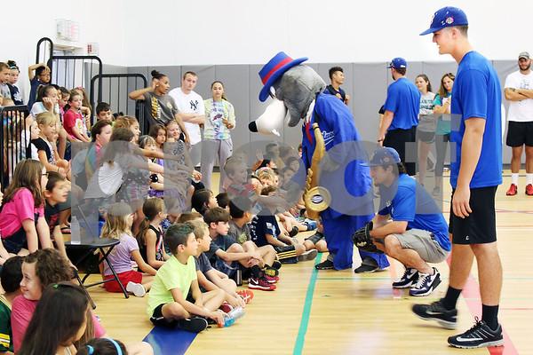 Players Chris Davis and Takoda Sitaon and mascot BB from the Bristol Blues visit children at the Boys & Girls Club for a meet and greet. The event was organized by Briana Root and George Klimek.