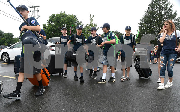 8/5/2017 Mike Orazzi | Staff Members of the Plainview (NY) Little League team arrive at the Giamatti Little League Center in Bristol for the start of the Eastern Regional Little Baseball Tournament in Bristol Saturday.