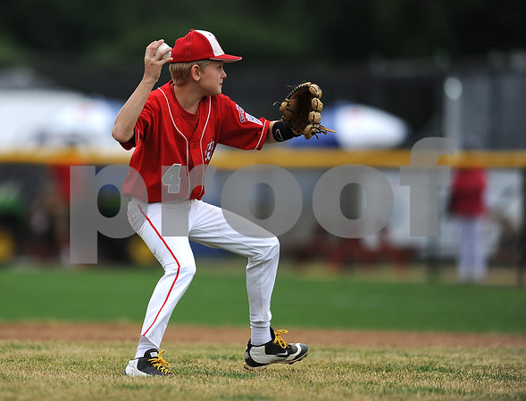 8/7/2017 Mike Orazzi | Staff New Jersey's Ryan Kinsman (4) fields a ground ball for the last out during the Eastern Regional Little League Tournament held at Breen Field in Bristol Monday.