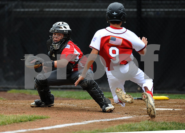 8/7/2017 Mike Orazzi | Staff Maine's Nolan Hobbs (19) tags out Connecticut's Sean O'Neil (9) at home plate during the Eastern Regional Little League Tournament held at Breen Field in Bristol Monday.