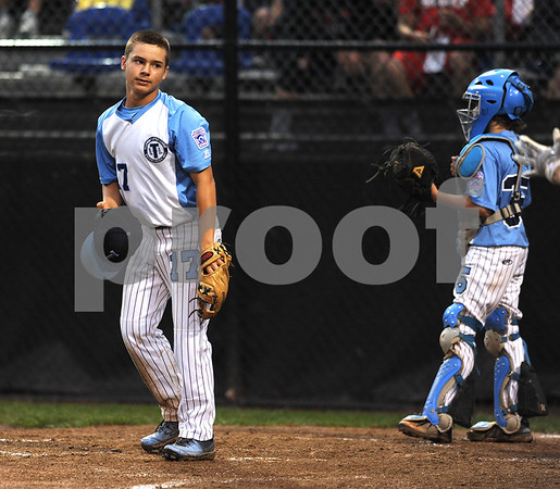 8/7/2017 Mike Orazzi | Staff Maryland's Logan Simanski (17) after Pennsylvania's Cam Paquette scored during the Eastern Regional Little League Tournament in Bristol Monday evening.