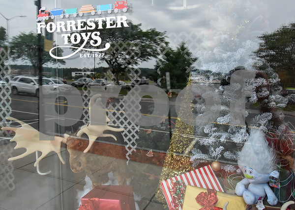 080717 Wesley Bunnell | Staff The former Barley & Vine Gastropub at 182 Main St. in Bristol has been transformed into Forrester Toys for the filming of Christmas Hours. The movie is starring Mario Lopez and Melissa Joan Hart.