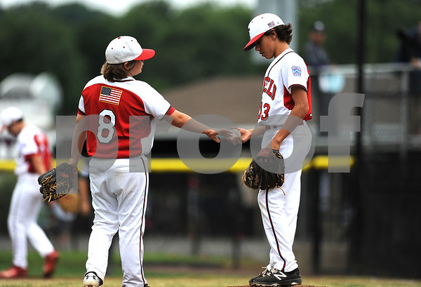 8/7/2017 Mike Orazzi | Staff Connecticut's Leo Randazzo (8) and Ethan Righter (13) during the Eastern Regional Little League Tournament held at Breen Field in Bristol Monday.