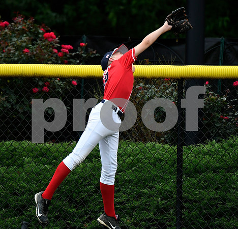 8/8/2017 Mike Orazzi | Staff Washington DC's Jack Sague (19) makes a leaping catch at the fence with the bases loaded during the Eastern Regional Little League Tournament in Bristol Tuesday morning.