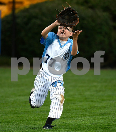 8/8/2017 Mike Orazzi | Staff Maryland's Peyton Castellow (77) makes a catch during the Eastern Regional Little League Tournament in Bristol Tuesday morning.