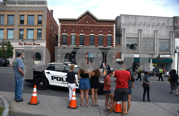 "8/8/2017 Mike Orazzi | Staff A crowd gathers across the street of the former Barley Vine on Main Street, that has been transformed into a toy store for the shooting of scenes for the upcoming movie ""Christmas Hours&quote;, starring Mario Lopez and Melissa Joan Hart, is being shot mostly in New Britain with some scenes in Bristol."