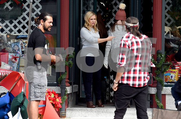 "8/8/2017 Mike Orazzi | Staff Melissa Joan Hart in front of the former Barley Vine on Main Street, that has been transformed into a toy store for the shooting of scenes for the upcoming movie ""Christmas Hours&quote;, starring Mario Lopez and Melissa Joan Hart, is being shot mostly in New Britain with some scenes in Bristol."