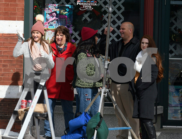 8/8/2017 Mike Orazzi | Staff Actors in front of the former Barley Vine on Main Street, that has been transformed into a toy store for the shooting of scenes for the upcoming movie Christmas Hours&quote;. Christmas Hours, starring Mario Lopez and Melissa Joan Hart, is being shot mostly in New Britain with some scenes in Bristol.