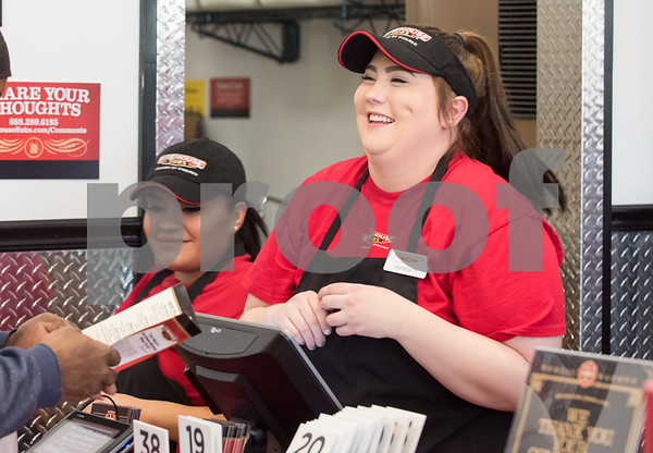 12/11/17 Wesley Bunnell | Staff Firehouse Subs opened for business on Monday at their new location at 594 Farmington Ave. Maria Hernandez, L, and Serenity Lucchesi-Nogiec smile as they assist a customer with his order.