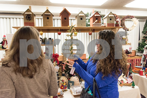 12/01/17 Wesley Bunnell | Staff The Berlin Historical Society Annual Holiday Fair opened Friday with an additional day Saturday from 9 a.m. to 4 p.m. Dawn Steimer looks over a Christmas decoration.