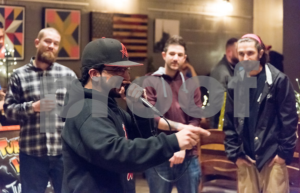 12/01/17 Wesley Bunnell | Staff The fourth annual Hip Hop for the Homeless benefit organized by Joe Battaglia was held at Alvarium Beer Co. on Thursday evening. New Britain resident Muggsy performs.