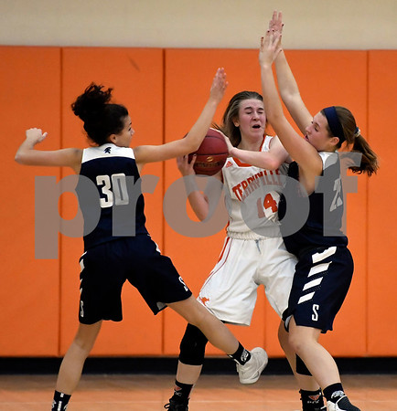 12/12/2017 Mike Orazzi | Staff Terryville's Mackenzie Huria (14) and Shepaug's Avery Serra (30) and Haylie Lasky (25) during Tuesday night's girl's basketball game at THS.