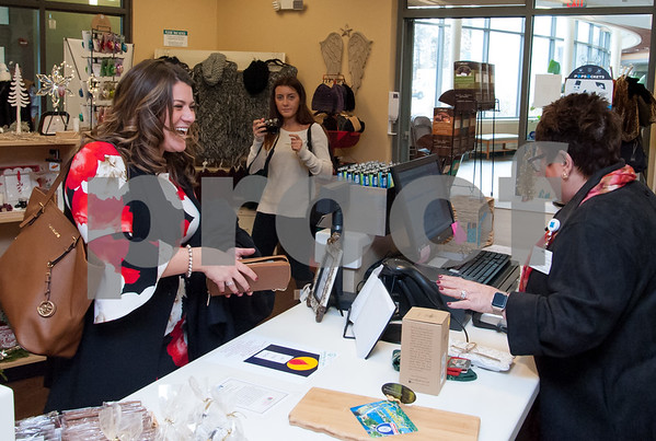 12/13/17 Wesley Bunnell | Staff The Hospital for Special Care held a ribbon cutting for their gift shop now run by Good Cause Gifts on Wednesday at noon. Mayor Erin Stewart purchases several items as she is assisted by Store Manager Sharon Faucher.