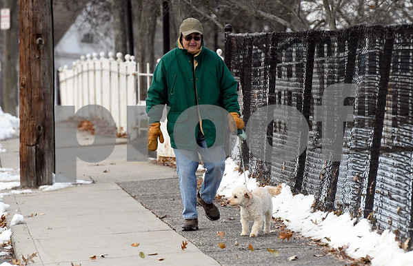 12/13/2017 Mike Orazzi | Staff Bob Kelly and his dog KC,6, walk near Federal Hill in Bristol on a blustery Wednesday afternoon.