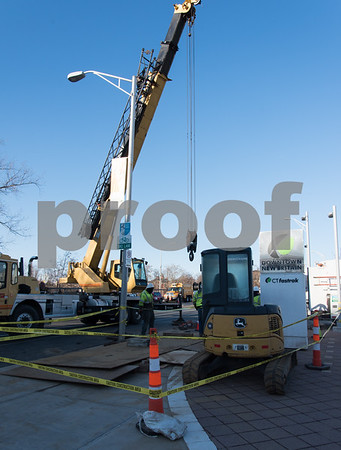 12/13/17 Wesley Bunnell | Staff Ever source crews work on a section of Main St. in front of the CTfastrak station on Wednesday afternoon.