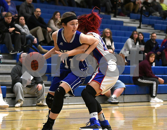 12/14/2017 Mike Orazzi | Staff Bristol Eastern's Hannah Maghini (11) and Plainville's Isabel Lozefski (10) Thursday night in Plainville.