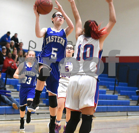 12/14/2017 Mike Orazzi | Staff Bristol Eastern's Miranda Janick (5) and Plainville's Isabel Lozefski (10) Thursday night in Plainville.