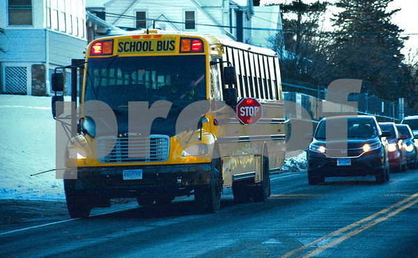 12/14/2017 Mike Orazzi | Staff A bus drops off children along South Street Thursday afternoon.