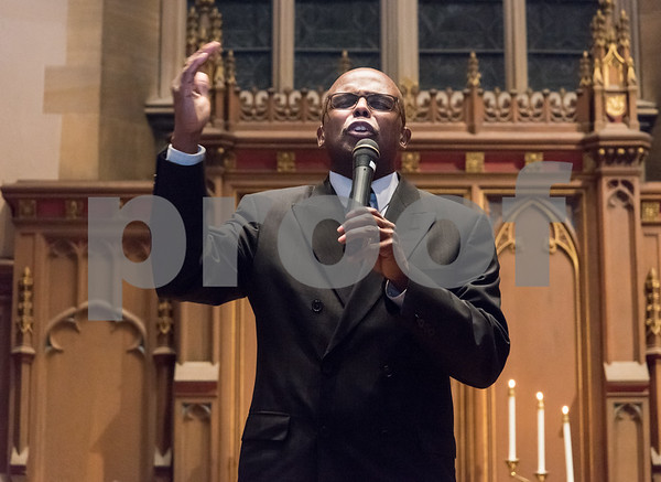 12/14/17 Wesley Bunnell | Staff A Prayer Vigil Against Gun Violence was held at South Church on Thursday evening to remember the shooting at Sandy Hook on its 5th anniversary. Rev. Gervais Barger of Peace Missionary Ministries offers a prayer.