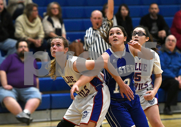 12/14/2017 Mike Orazzi | Staff Plainville'sCaitlin Barker (3) and Bristol Eastern's Karly Martin (12) Thursday night in Plainville.