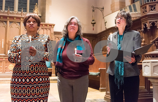 12/14/17 Wesley Bunnell | Staff A Prayer Vigil Against Gun Violence was held at South Church on Thursday evening to remember the shooting at Sandy Hook on its 5th anniversary. Pastor Pauline Wilkins of Another Chance Church, Rev. Margret Hofmeister of First Church of Christ and Rev. Jane H. Rowe of South Church stand with lit candles to send a message of unity and remembrance of the mass shooting.