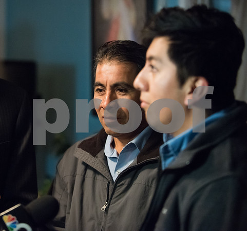 12/15/17 Wesley Bunnell | Staff New Britain resident Mario Cardoso Sr. was given a last minute stay of removal Friday afternoon on the day he was facing deportation to his native Mexico. Mario Cardoso Sr. , L, stands next to his son Mario Cardoso Jr. during a press conference at their New Britain home on Friday evening.