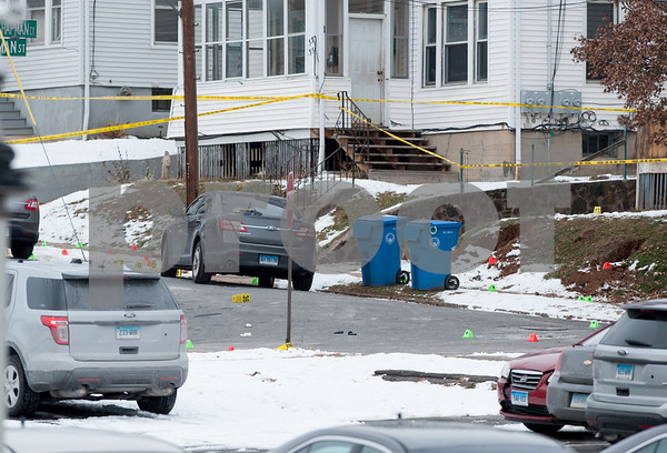 12/15/17 Wesley Bunnell | Staff State and New Britain Police on Friday morning at the intersection of Chapman St and Chapman Ct where an officer involved shooting occurred on Thursday evening involving three suspects in a green Toyota. Evidence markers in different colors are shown.