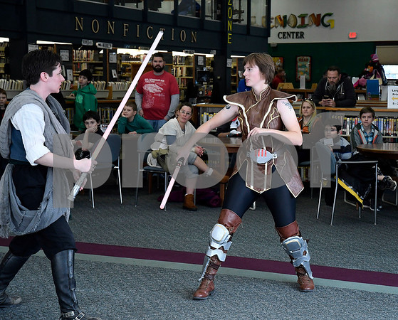 12/16/2017 Mike Orazzi | Staff Granite State Saber Academy's Adrian Johnson and Kristal Terpstra during a lightsaber battle at the Star Wars event at the Southington Public Library Saturday afternoon.