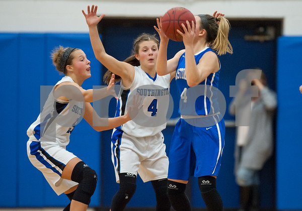 12/18/17 Wesley Bunnell | Staff Southington girls basketball was defeated by Glastonbury Monday evening at Southington High School. Alli Carr (15) and Livvy Pizzitolia (4).