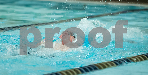 12/19/17 Wesley Bunnell | Staff Newington boys swimming defeated Manchester 94-69 on Tuesday afternoon at Newington High School. Sean Abrams of Newington competes in the 100m backstroke.