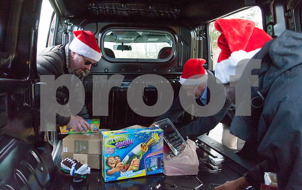 12/20/17 Wesley Bunnell | Staff Papas Dodge delivered donations to the Prudence Crandall Center on Wednesday afternoon as part of its fill the van drive held over the last several weeks. Household items were collected at the dealership such as bedding, clothes, small appliances and other household necessities clients of the center who are victims of domestic violence. General Manager Sean Lawlor, L, Service and Parts Director Phil Vetre and Quaid Collomore.