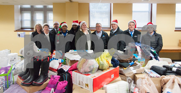 12/20/17 Wesley Bunnell | Staff Papas Dodge delivered donations to the Prudence Crandall Center on Wednesday afternoon as part of its fill the van drive held over the last several weeks. Household items were collected at the dealership such as bedding, clothes, small appliances and other household necessities clients of the center who are victims of domestic violence. Prudence Crandall Center Development Director Carolyn Jasper, Executive Director Barbara Damon, General Manager Sean Lawlor, Detail Department Supervisor Eugenio Rosario, Quaid Collomore, Receptionist Brianna Emmendover, Service and Parts Director Phil Vetre, Parts Assistant Manager Tom Shirley, Body Shop Manager Marty Mattei and Jordan McMahon.