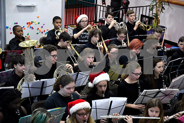 12/21/2017 Mike Orazzi | Staff Members of the Northeast Middle School Tigers Wind Ensemble perform during a Christmas concert at theImagine Nation, A Museum Early Learning Center Thursday afternoon.