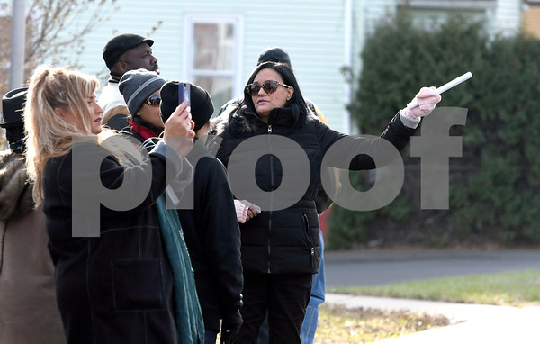 12/2/2017 Mike Orazzi | Staff Oak Street area resident Annette Velez points out conditions along Oak Street in New Britain during a neighborhood walk Saturday morning.