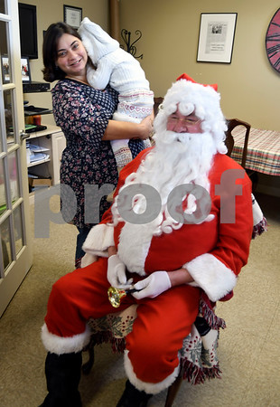 12/2/2017 Mike Orazzi | Staff Vivian Durity,2 1/2, and her mom Carla meet with Santa at Good Cause Gifts in Berlin Saturday morning.