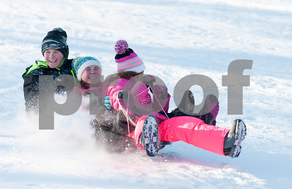 12/26/17 Wesley Bunnell | Staff Families took advantage of good sledding conditions at Page Park on Tuesday afternoon. Siblings Jedric, age 12, Kyleigh, age 10, and Corinne Setula slide together downhill.