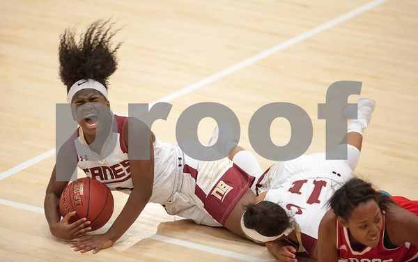 12/29/17 Wesley Bunnell | Staff New Britain basketball was defeated by visiting Wilbur Cross 56-28 on Friday evening at New Britain High School. Inanna Rice (1) is injured fighting for a rebound as players fall on her left leg.