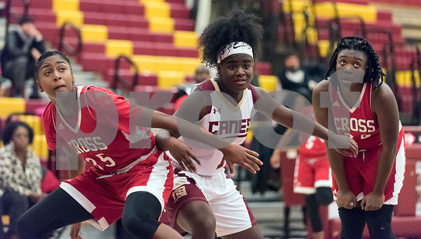 12/29/17 Wesley Bunnell | Staff New Britain basketball was defeated by visiting Wilbur Cross 56-28 on Friday evening at New Britain High School. Inanna Rice (1) tries to box out during a free throw.
