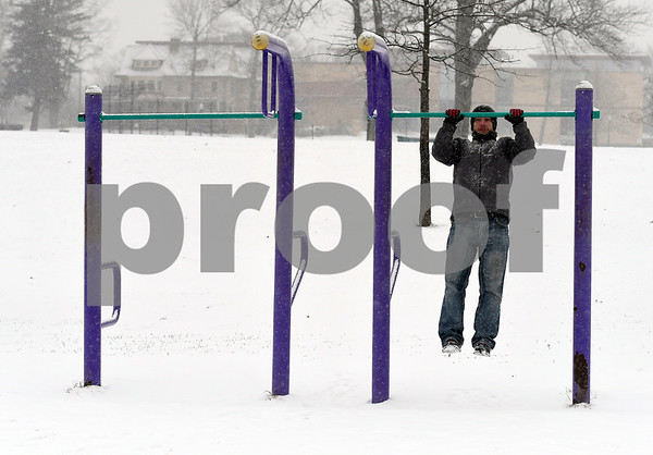 12/30/2017 Mike Orazzi | Staff Pawel Zarow works out in New Britain's Walnut Hill Park during Saturday's snow storm.