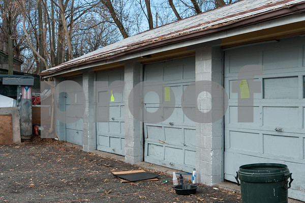 12/06/17 Wesley Bunnell | Staff A garage behind 116 West Street in the North Oak Section of New Britain with signs marking the building as condemned and unsafe after a fire in February 2017. Residents of the neighborhood have recently been speaking up regarding blight and alleged neglect from the city regarding their concerns.