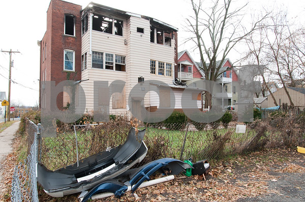 12/06/17 Wesley Bunnell | Staff Trash and other items behind 116 West Street in the North Oak Section of New Britain which was the scene of a fire in February 2017. Residents of the neighborhood have recently been speaking up regarding blight and alleged neglect from the city regarding their concerns.