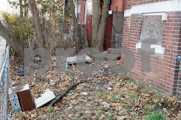 12/06/17 Wesley Bunnell | Staff Trash and other items in the front of 24 Tremont St in the North Oak Section of New Britain. Residents of the neighborhood have recently been speaking up regarding blight and alleged neglect from the city regarding their concerns.