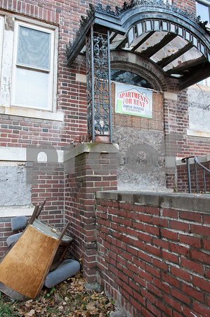 12/06/17 Wesley Bunnell | Staff Trash and other items near the entrance to 24 Tremont St in the North Oak Section of New Britain. Residents of the neighborhood have recently been speaking up regarding blight and alleged neglect from the city regarding their concerns.