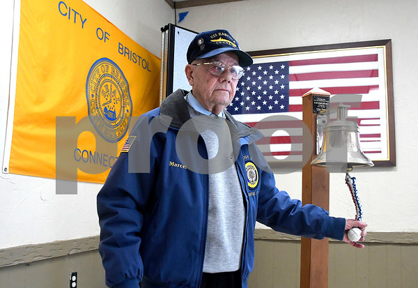 12/7/2017 Mike Orazzi | Staff WWII veteran Marcel Simoneau rings the bell from the USS Kidd (DD-661) during the Pearl Harbor Day ceremony at Bristol American Legion Thursday morning.