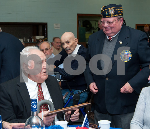 12/07/17 Wesley Bunnell | Staff The VFW of New Britain held their annual officer installation and award ceremony on Thursday evening. Veteran of the year Ed Mackiewicz receives his award from newly appointed VFW President Thomas Higgins.