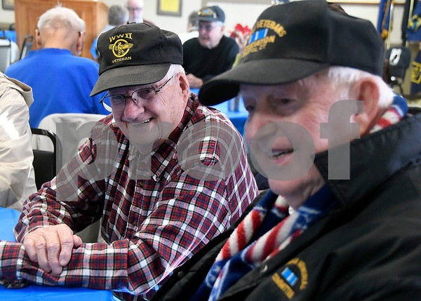 12/7/2017 Mike Orazzi | Staff WWII veteran Dick Fitz and Korean War veteran Ed Pelkey during the Pearl Harbor Day at Bristol American Legion Thursday morning.