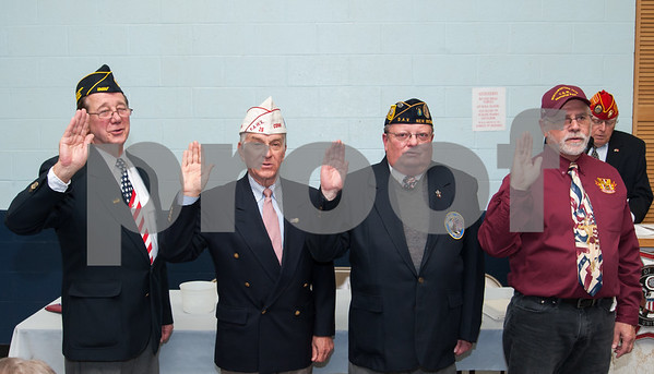 12/07/17 Wesley Bunnell | Staff The VFW of New Britain held their annual officer installation and award ceremony on Thursday evening. Newly sworn in officers Senior Vice President Dennis Taricani, Treasurer Thomas Bozek, President Thomas Higgins and Judge Advocate William Flynn.